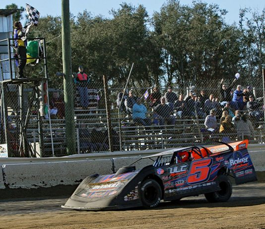 Mark Whitener takes the checkered flag to win Sunday's DIRTcar-sanctioned late model feature at North Florida Speedway. (Jim Denhamer Photo)