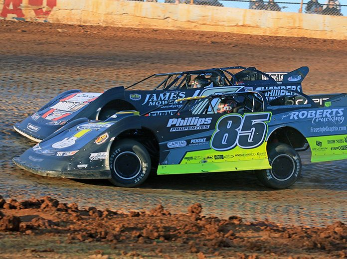 Jason Hiett (85) battles eventual race winner John Ownbey during Sunday's Schaeffer's Oil Iron-Man Championship Late Model Series race at Boyd's Speedway. (Chad Wells Photo)
