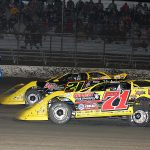 Hudson O'Neal (71) races alongside Billy Moyer Jr. during Monday's Lucas Oil Late Model Dirt Series feature at East Bay Raceway Park. (Mike Ruefer Photo)
