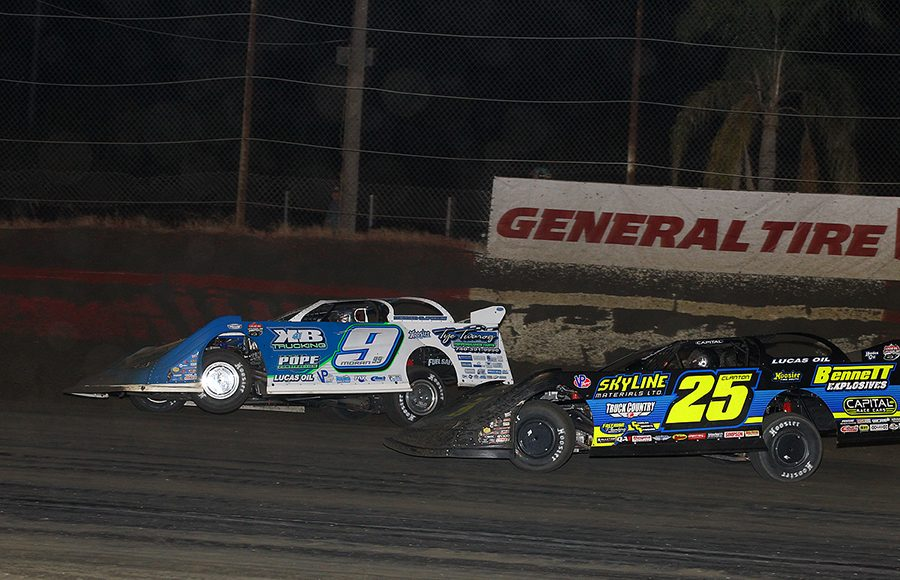 Devin Moran (9) battles Shane Clanton during Wednesday's Lucas Oil Late Model Dirt Series feature at East Bay Raceway Park. (Mike Ruefer Photo)