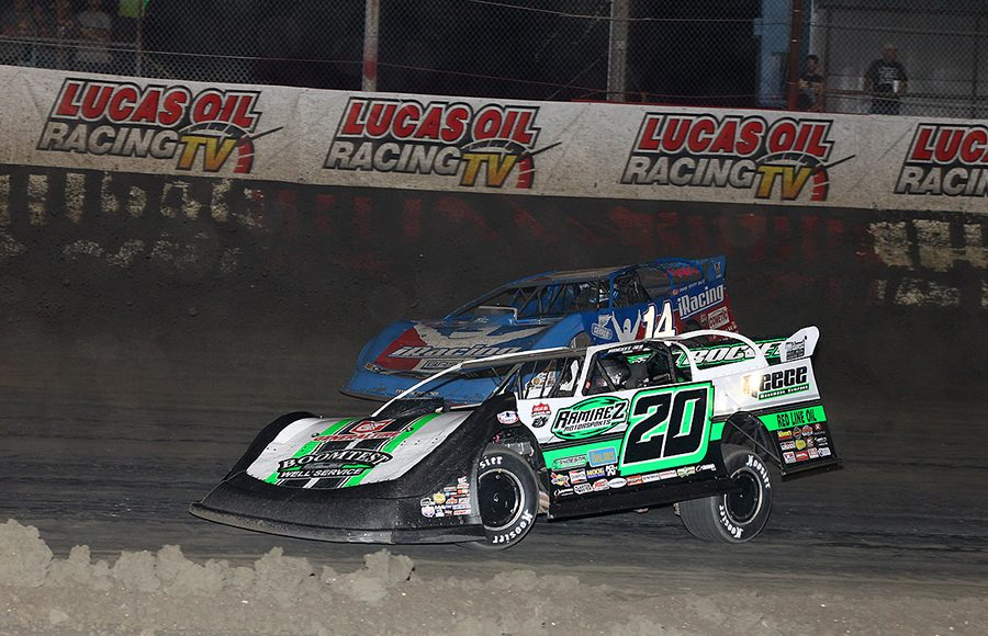 Jimmy Owens (20) races under Josh Richards during Wednesday's Lucas Oil Late Model Dirt Series feature at East Bay Raceway Park. (Mike Ruefer Photo)