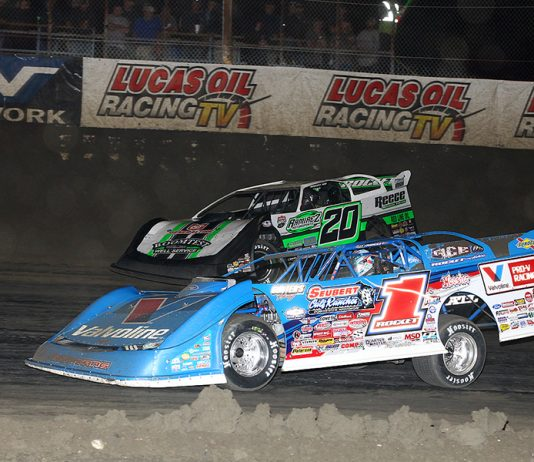 Brandon Sheppard (1) races under Jimmy Owens during Wednesday's Lucas Oil Late Model Dirt Series feature at East Bay Raceway Park. (Mike Ruefer Photo)