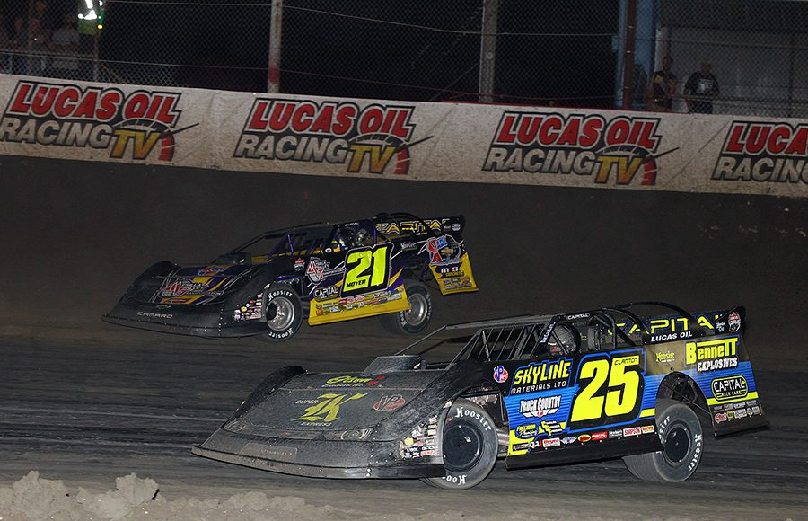 Shane Clanton (25) races under Billy Moyer during Wednesday's Lucas Oil Late Model Dirt Series feature at East Bay Raceway Park. (Mike Ruefer Photo)