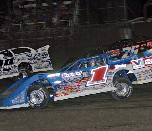 Brandon Sheppard (1) works through traffic on his way to victory Thursday at East Bay Raceway Park. (Jim DenHamer photo)