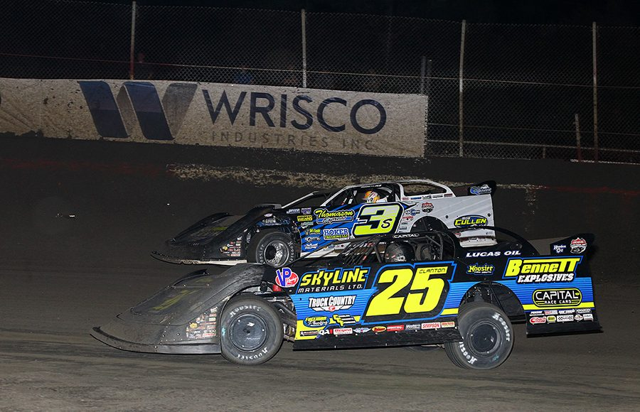 Shane Clanton (25) races alongside Brian Shirley during Thursday's Lucas Oil Late Model Dirt Series feature at East Bay Raceway Park. (Mike Ruefer Photo)