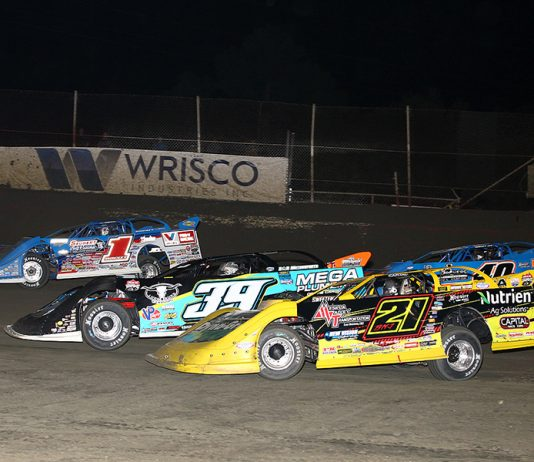Billy Moyer Jr. (21), Tim McCreadie (39), Brandon Sheppard (1) and Kyle Bronson battle for position during Thursday's Lucas Oil Late Model Dirt Series feature at East Bay Raceway Park. (Mike Ruefer Photo)