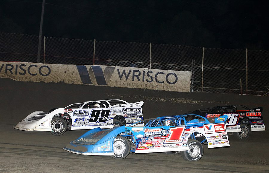 Brandon Sheppard (1), Boom Briggs (99) and Brandon Overton race for position during Thursday's Lucas Oil Late Model Dirt Series feature at East Bay Raceway Park. (Mike Ruefer Photo)