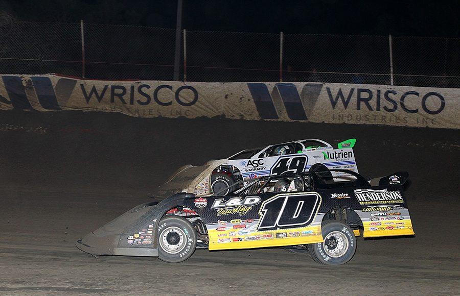 David Breazeale (10) battles Jonathan Davenport during Thursday's Lucas Oil Late Model Dirt Series feature at East Bay Raceway Park. (Mike Ruefer Photo)