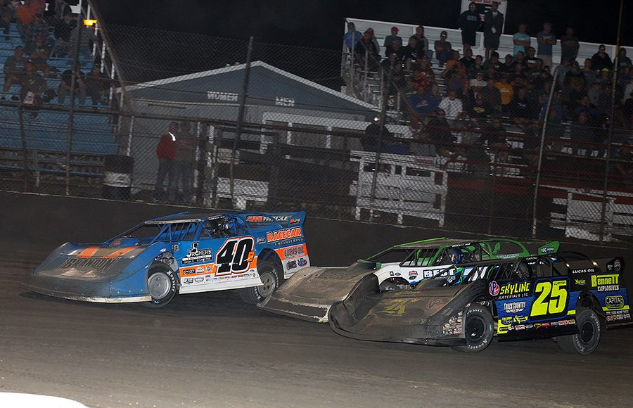 Kyle Bronson (40B), Tyler Erb (1) and Shane Clanton race three-wide during Thursday's Lucas Oil Late Model Dirt Series feature at East Bay Raceway Park. (Mike Ruefer Photo)