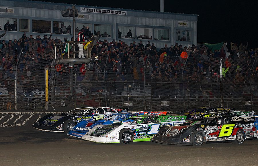 The field for Friday's Lucas Oil Late Model Dirt Series race at East Bay Raceway Park goes four-wide to salute the fans. (MIke Ruefer Photo)