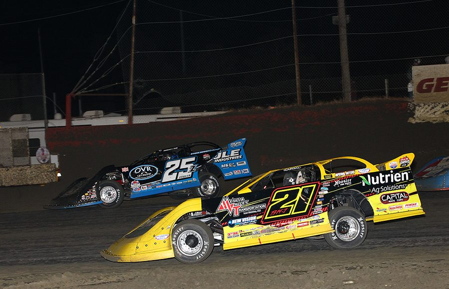 Billy Moyer Jr. (21) races under Mason Zeigler during Friday's Lucas Oil Late Model Dirt Series race at East Bay Raceway Park. (Mike Ruefer Photo)