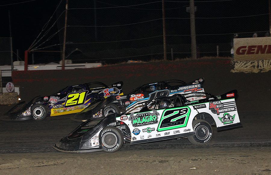 Stormy Scott (2), Chase Junghans (18) and Billy Moyer race three-wide during Friday's Lucas Oil Late Model Dirt Series race at East Bay Raceway Park. (Mike Ruefer Photo)
