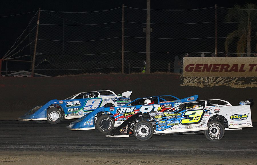 Brian Shirley (3), Tanner English (81) and Devin Moran battle for position during Friday's Lucas Oil Late Model Dirt Series race at East Bay Raceway Park. (Mike Ruefer Photo)