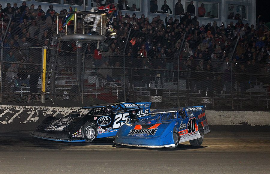 Mason Zeigler (25) beats Kyle Bronson to the checkered flag to win Friday's Lucas Oil Late Model Dirt Series feature at East Bay Raceway Park. (Mike Ruefer Photo)