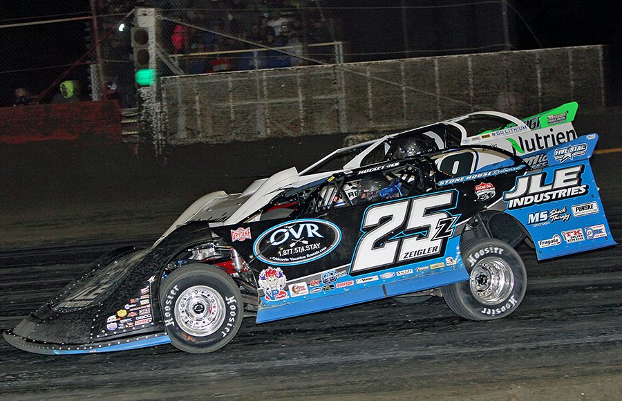 Mason Zeigler (25) battles Jonathan Davenport during Friday's Lucas Oil Late Model Dirt Series race at East Bay Raceway Park. (Jim Denhamer Photo)