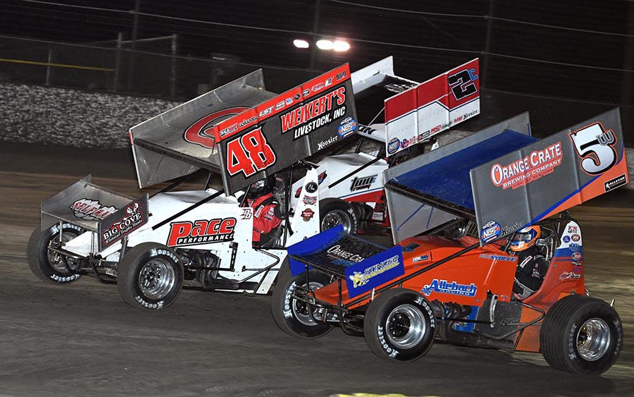 Lucas Wolfe (5w), Danny Dietrich (48) and Wayne Johnson battle for position during Friday's World of Outlaws NOS Energy Drink Sprint Car Series opener at Volusia Speedway Park. (Frank Smith Photo)