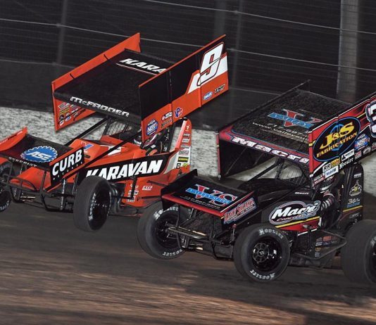 James McFadden (9) races around the outside of Anthony Macri during Friday's World of Outlaws NOS Energy Drink Sprint Car Series opener at Volusia Speedway Park. (Frank Smith Photo)