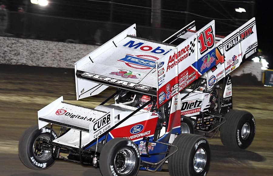 Donny Schatz (15) battles Parker Price-Miller during Friday's World of Outlaws NOS Energy Drink Sprint Car Series opener at Volusia Speedway Park. (Frank Smith Photo)