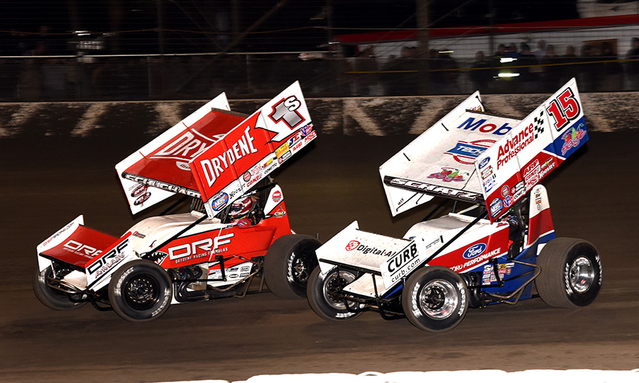 Logan Schuchart (1s) leads Donny Schatz during Friday's World of Outlaws NOS Energy Drink Sprint Car Series opener at Volusia Speedway Park. (Paul Arch Photo)