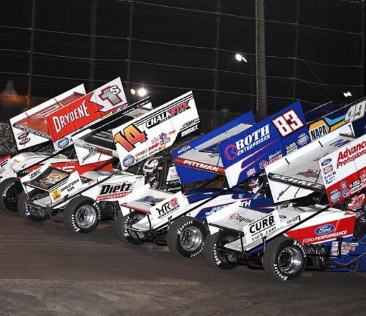 The World of Outlaws NOS Energy Drink Sprint Car Series field goes four-wide to salute the fans Friday evening at Volusia Speedway Park. (Frank Smith Photo)