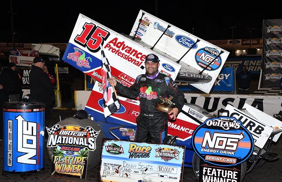 Donny Schatz poses in victory lane after winning Friday's World of Outlaws NOS Energy Drink Sprint Car Series feature at Volusia Speedway Park. (Frank Smith Photo)