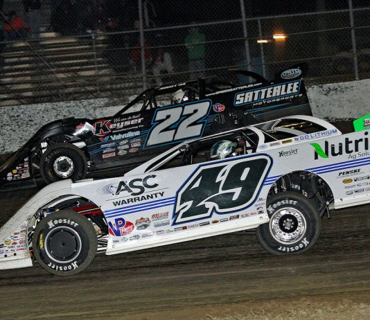 Jonathan Davenport (49) races under Gregg Satterlee at All-Tech Raceway. (Jim DenHamer photo)