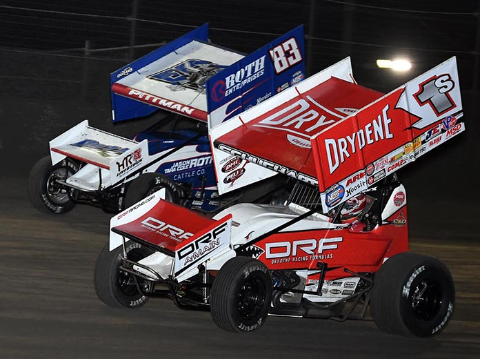 Logan Schuchart (1s) battles Daryn Pittman during Sunday's World of Outlaws feature at Volusia Speedway Park. (Frank Smith Photo)