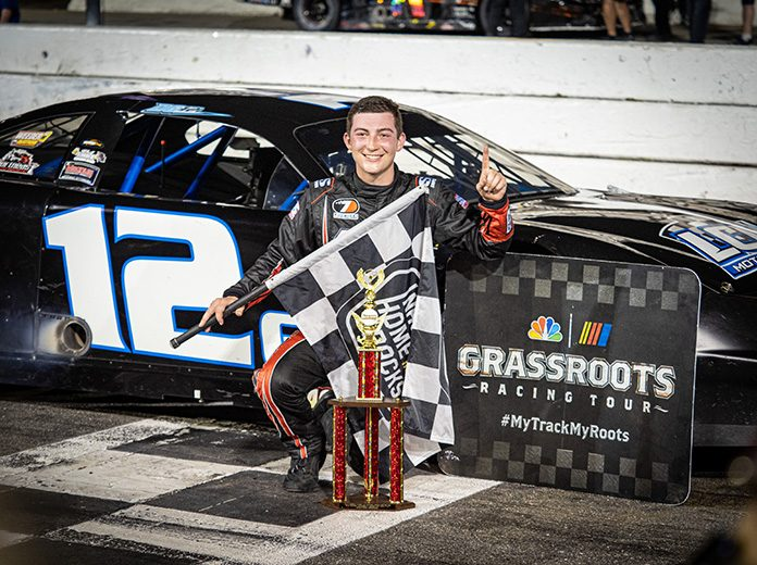 Derek Griffith in victory lane Tuesday at New Smyrna Speedway. (Jason Reasin Photo)