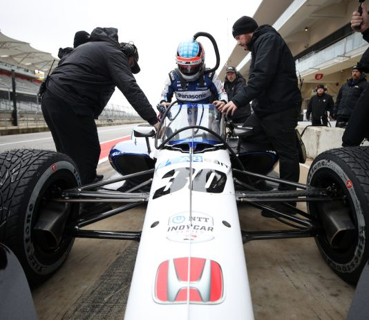 Takuma Sato climbs into his Indy car at Circuit of The Americas. (Photo by Chris Graythen/Getty Images)