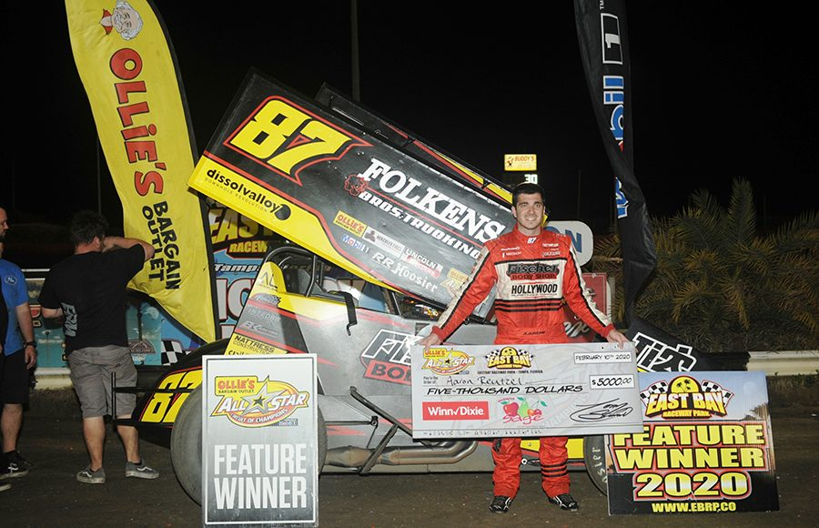 Aaron Reutzel poses in victory lane after winning Monday's Ollie's Bargain Outlet All Star Circuit of Champions feature at East Bay Raceway Park. (Julia Johnson Photo)
