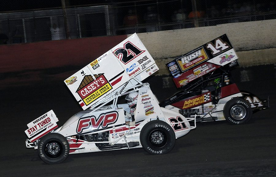 Brian Brown (21) battles Tony Stewart during Monday's Ollie's Bargain Outlet All Star Circuit of Champions feature at East Bay Raceway Park. (Steve Bischoff Photo)