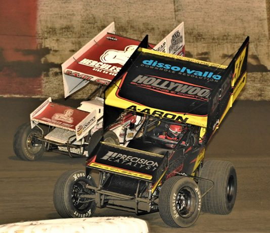 Aaron Reutzel (87) leads Greg Wilson during Monday's Ollie's Bargain Outlet All Star Circuit of Champions main event at East Bay Raceway Park. (Al Steinberg Photo)