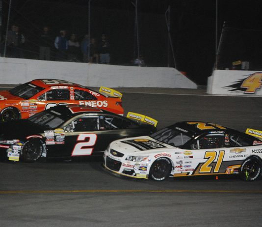 Sam Mayer (21), Derek Griffith (2) and Gracie Trotter race three-wide during Monday's ARCA Menards Series East opener at New Smyrna Speedway. (David Sink Photo)