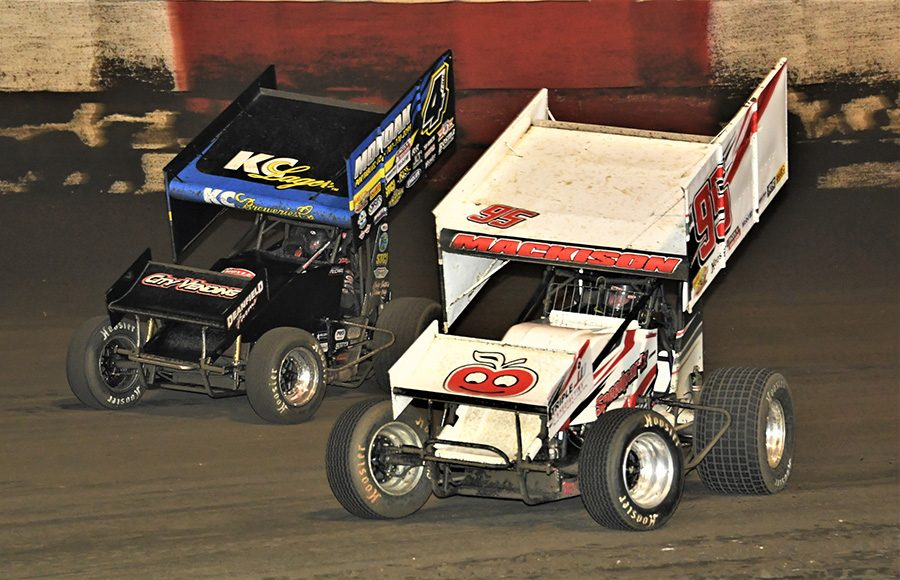 Hunter Mackison (95) races alongside Carson McCarl during Tuesday's Ollie's Bargain Outlet All Star Circuit of Champions feature at East Bay Raceway Park. (Al Steinberg Photo)