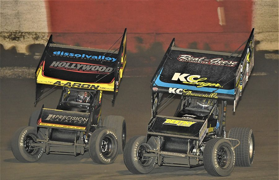 Aaron Reutzel (87) battles Terry McCarl during Tuesday's Ollie's Bargain Outlet All Star Circuit of Champions feature at East Bay Raceway Park. (Al Steinberg Photo)