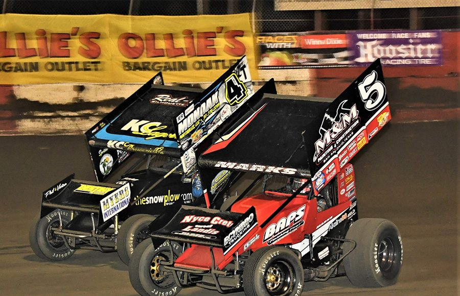 Brent Marks (5) battles Terry McCarl during Tuesday's Ollie's Bargain Outlet All Star Circuit of Champions feature at East Bay Raceway Park. (Al Steinberg Photo)