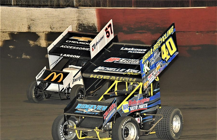George Hobaugh (40) races under Kyle Larson during Tuesday's Ollie's Bargain Outlet All Star Circuit of Champions feature at East Bay Raceway Park. (Al Steinberg Photo)