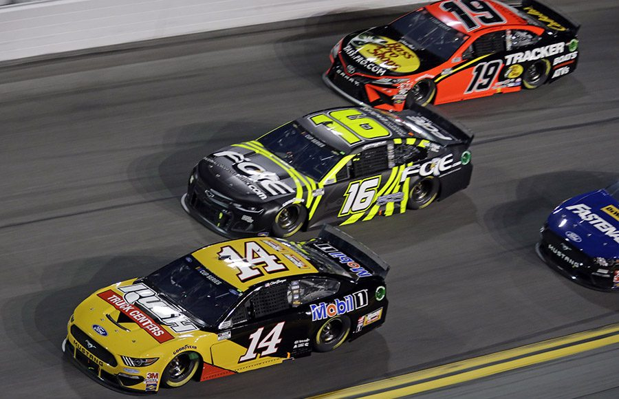 Clint Bowyer (14), Justin Haley (16) and Martin Truex Jr. race three-wide during the first Bluegreen Vacations Duel Thursday at Daytona Int'l Speedway. (HHP/Alan Marler Photo)
