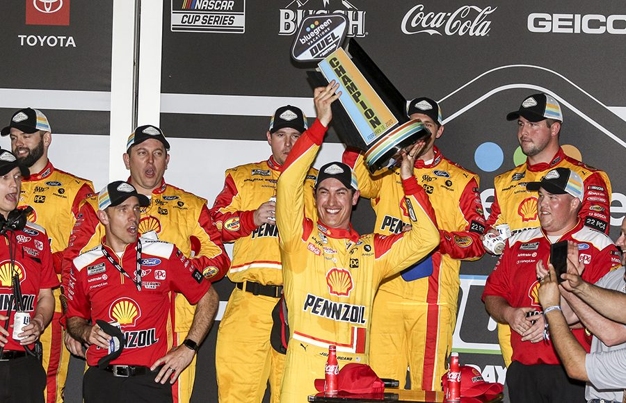 Joey Logano celebrates in victory lane after winning the first Bluegreen Vacations Duel Thursday at Daytona Int'l Speedway. (Dick Ayers Photo)