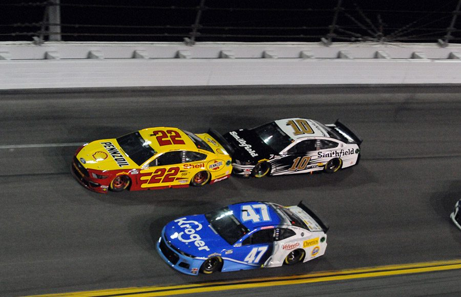 Ryan Preece (47), Joey Logano (22) and Aric Almirola battle for the lead during the first Bluegreen Vacations Duel Thursday at Daytona Int'l Speedway. (Dave Moulthrop Photo)