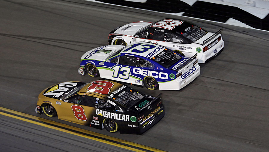 Tyler Reddick (8), Ty Dillon (13) and B.J. McLeod race three-wide during the second Bluegreen Vacations Duel Thursday at Daytona Int'l Speedway. (HHP/Alan Marler Photo)