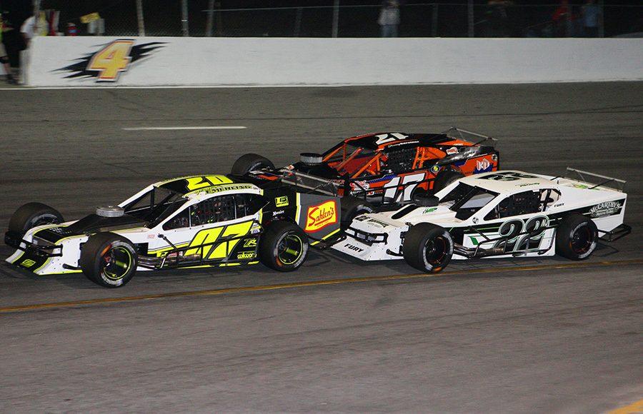 Patrick Emerling (07) races with Eddie McCarthy (22) and Tyler Rypkema during Wednesday's John Blewett III Memorial 76 at New Smyrna Speedway. (Todd Ridgeway Photo)