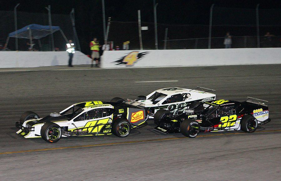 Patrick Emerling (07) Jeremy Gerstner (17) and Eddie McCarthy battle for position during Wednesday's John Blewett III Memorial 76 at New Smyrna Speedway. (Todd Ridgeway Photo)