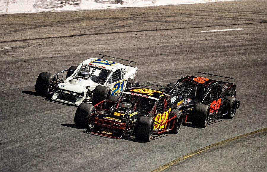 Anthony Nocella (92), Matt Hirscshman (60) and Jimmy Blewett battle for the lead during Wednesday's John Blewett III Memorial 76 at New Smyrna Speedway. (Jason Reasin Photo)