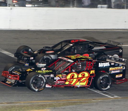 Anthony Nocella (92) battles Matt Hirschman for the race lead during Wednesday's John Blewett III Memorial 76 at New Smyrna Speedway. (Dick Ayers Photo)