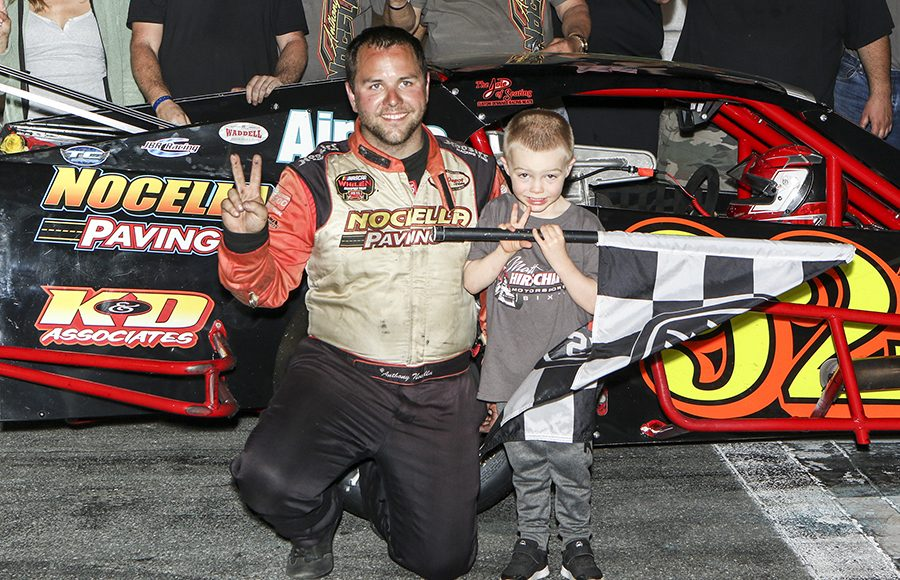 Anthony Nocella poses in victory lane after winning Wednesday's John Blewett III Memorial 76 at New Smyrna Speedway. (Dick Ayers Photo)