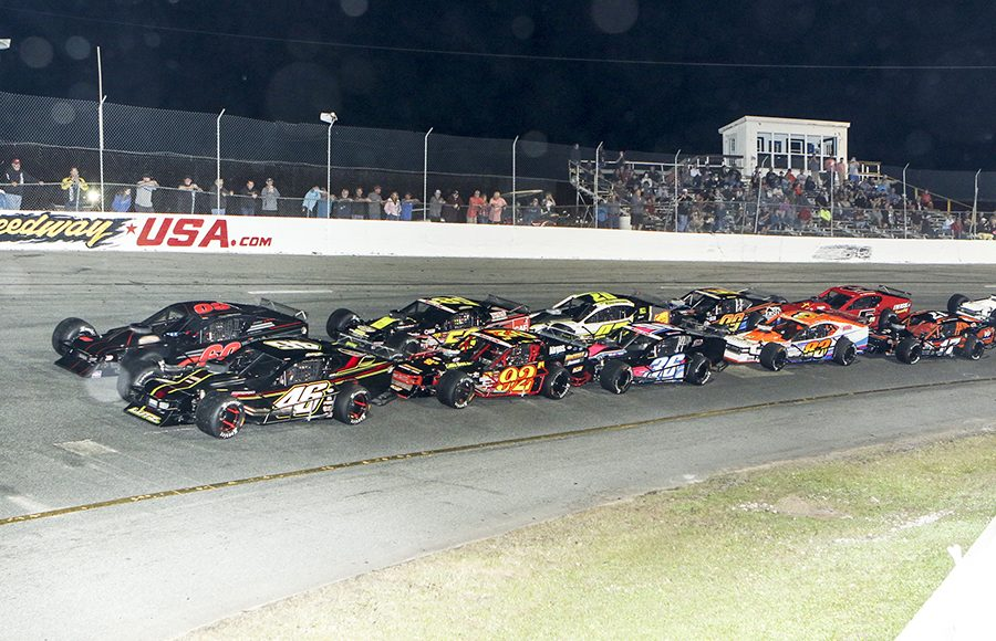 The field for Wednesday's John Blewett III Memorial 76 at New Smyrna Speedway prepares to go racing. (Dick Ayers Photo)