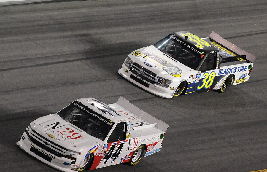 Natalie Decker (44) races ahead of Todd Gilliland during Friday's NASCAR Gander RV & Outdoors Truck Series opener at Daytona Int'l Speedway. (Dave Moulthrop Photo)