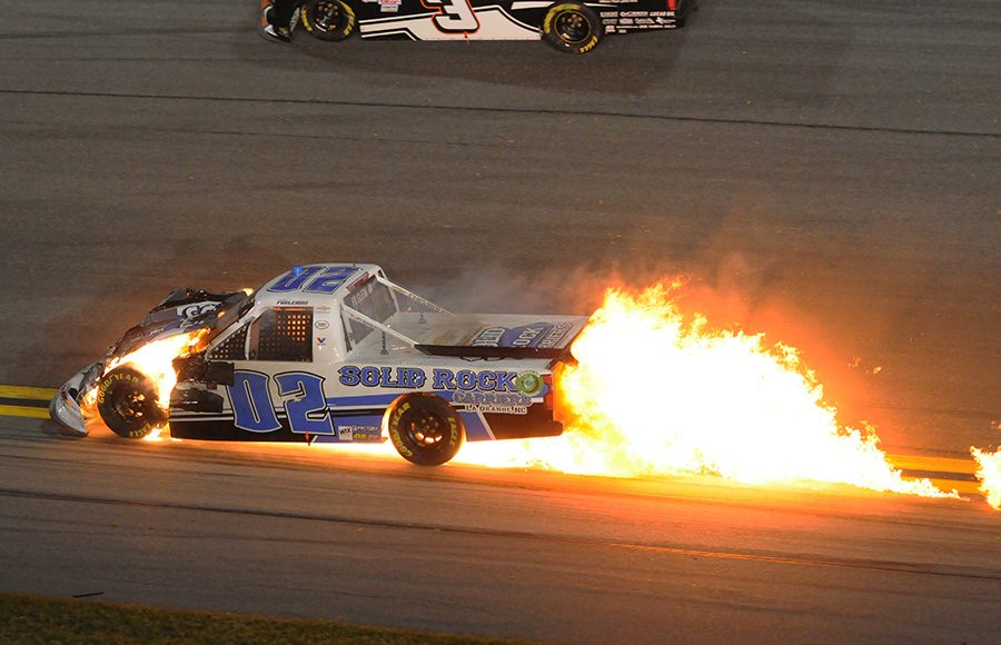 Tate Fogleman's truck bursts into flames after a crash during Friday's NASCAR Gander RV & Outdoors Truck Series opener at Daytona Int'l Speedway. (Dave Moulthrop Photo)