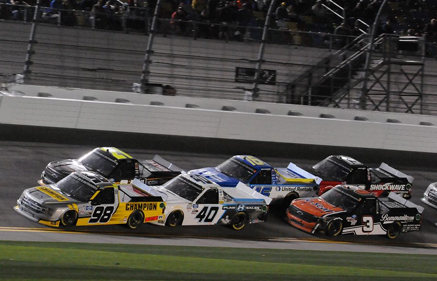 Grant Enfinger (98) gets a push from Ross Chastain (40) during a restart in Friday's NASCAR Gander RV & Outdoors Truck Series opener at Daytona Int'l Speedway. (Dave Moulthrop Photo)